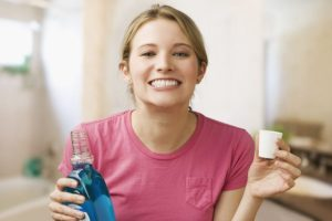 Woman with mouthwash image