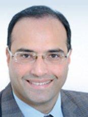 Dr Ashish Deved