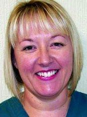 Ms Sharon James