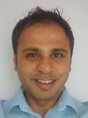 Dr M. Asjad Tai